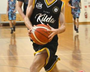 St Kilda Saints guard Michael Ruske takes a lay-up in their club basketball match against the...