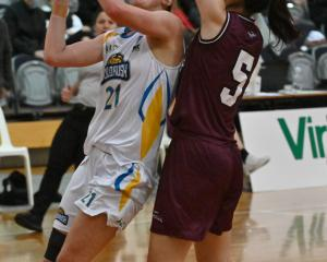 Otago Gold Rush guard Nicole Ruske takes the ball to the hoop pressured by Harbour Breeze guard...