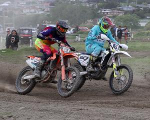 Madison Latta, of Balclutha (right), passes Liam Shepherd, of Invercargill, on his way to MX2...