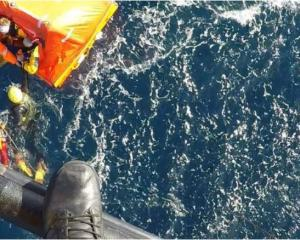 The moment four stricken crew members were winched to safety from a drifting life raft in the...