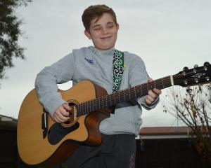 Mosgiel boy Caleb Croy with the guitar he won at the Gold Guitar Awards in Gore. PHOTO: GREGOR...