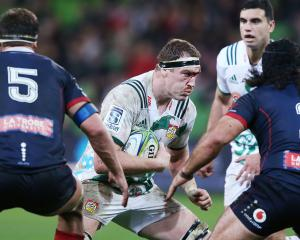 A bloddied Brodie Retallick runs with the ball during the match between the Rebels and the Chiefs...