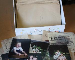 Just one of six boxes  full of old colour studio portrait and family photos and negatives  from...