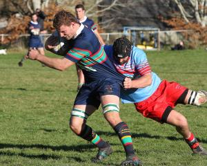 Southern Region No 8 Cole Birse latches on to his Central Otago counterpart, Dean Sinnamon,...