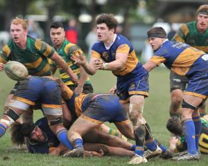 Taieri's Bob Martin clears the ball from a ruck against Green Island at Peter Johnstone Park on...