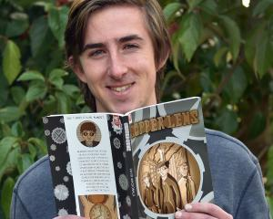 Dunedin Polytechnic student, David Macdonald with his award-winning comic Copper Lens at Otago...