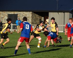 Upper Clutha hooker Joe Cairns sets off on a run against Maniototo, at Wanaka on Saturday....