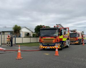Firefighters at the scene of the house fire in Dome St, Invercargill. Photo: Abbey Palmer