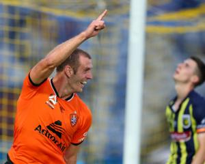 Luke DeVere celebrates scoring for the Brisbane Roar. Photo: Getty