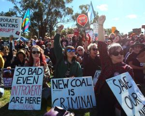 Activists take part in an anti-Adani rally outside Australia's Parliament House in Canberra last...