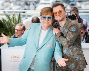 "Elton John and Taron Egerton attend the photocall for ""Rocketman"" during the 72nd annual Cannes..."