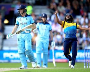 Sri Lanka's Lasith Malinga (R) celebrates the dismissal of England's Jos Buttler (L). Photo: PA...