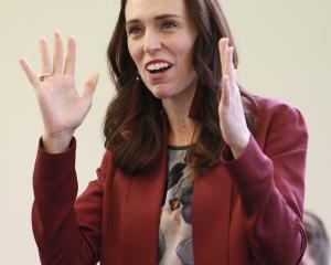 New Zealand Prime Minister Jacinda Ardern speaks to people upon arriving at the Mangere Community...