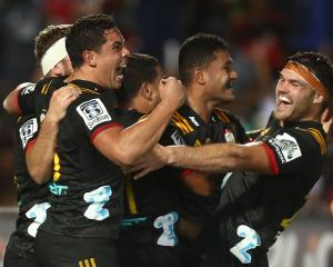 Chiefs players celebrate a try to Tumua Manu. Photo: Getty