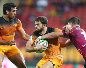 The Jaguares' Ramiro Moyano tries to get away from the Reds defence. Photo: Getty