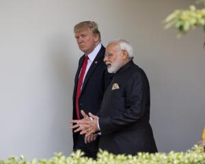 US President Donald Trump and Indian PM Narendra Modi speak during a bilateral meeting in...