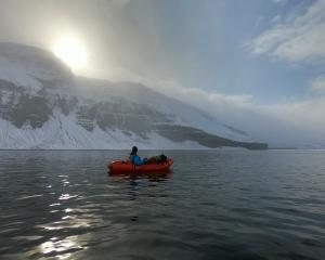 Dr Richard Stephenson, of Dunedin, moves to the south Skjalfandafljot River on his inflatable...