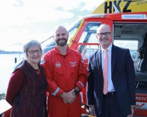 Land Information Minister Eugenie Sage and Transport Minister Phil Twyford with rescue helicopter...