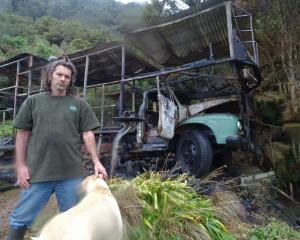 Piers Wilkinson with his burnt-out truck. Photo: Brendon McMahon