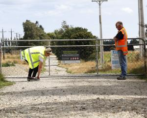 In January, a WorkSafe New Zealand official examines the Gore sewage treatment site gate through...