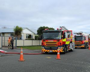 "Firefighters arrive at a ""well involved'' fire in the garage of a property in the Invercargill..."