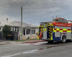 Smoke rises from a house fire in Invercargill this afternoon. Photo: Abbey Palmer