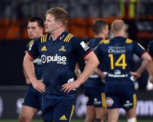 Highlanders flanker James Lentjes and team-mates are dejected after losing to the Hurricanes at...