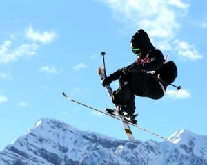 Jossi Wells flies high in the Freestyle Skiing Men's Ski Slopestyle Qualificatioa.  (Photo by...