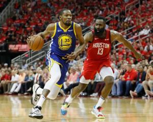 Kevin Durant takes the ball to the hoop against James Harden earlier in the playoffs. Photo:...