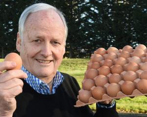 Mainland managing director Michael Guthrie with stamped eggs at the company's Waikouaiti farm...