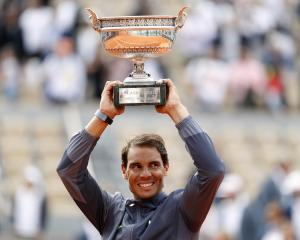 Spain's Rafael Nadal celebrates with the trophy after his final match against Austria's Dominic...
