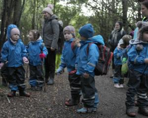 Children from Winton Kindergarten head out for their morning nature-based learning experience on...
