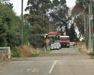 Police work at the scene of a fatal crash in TY Duncan Rd, Oamaru, yesterday. PHOTO: HAMISH...