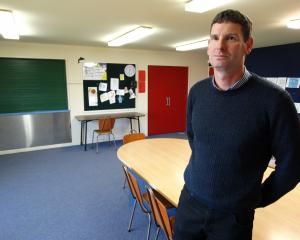 Fenwick School principal Rodney McLellan in the school's converted classroom in the school's hall...