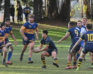 Taieri and Dunedin play at Peter Johnstone Park in Mosgiel last week. Photo: Gerard O'Brien