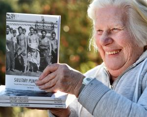 Pat Greer, of Dunedin, holds the published book titled Salutary Punishment, written by her...