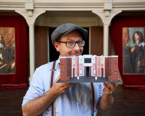 Pop-up Globe founder Dr Miles Gregory with a model of the set he is bringing to Dunedin. PHOTO:...