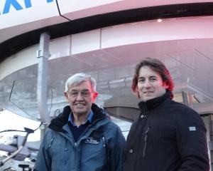 NZSki owner Sir John Davies (left) and chief executive Paul Anderson are all smiles at Coronet...