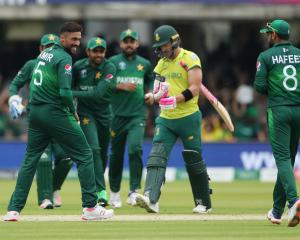 Pakistan's Mohammad Amir celebrates taking the wicket of South Africa's Faf du Plessis. Photo:...
