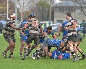 Harbour and Southern battle it out in the mud at Bathgate Park this afternoon. Photo: Linda...
