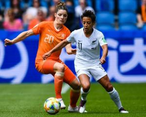 Sarah Gregorius and Dominque Bloodworth contest the ball during the Football Ferns match against...