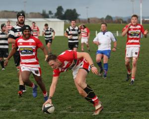 Halfback Ollie Kenny scores under the posts for Clutha's opening try in its Southern Region top...