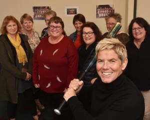 Brigid Inder, of Queenstown, with her old softball team during their reunion at the Rope and...