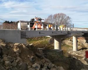 The new bridge over the Taieri River, near Sutton, is almost finished and expected to be open...