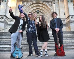 Velvet Strings band members (from left) Seth Fleming (15), Max White (15), Jayda Smither (14) and...