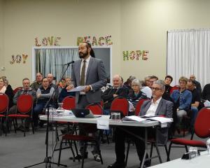 Barrister James Gardner-Hopkins (standing) presents evidence on behalf of residents opposed to ...