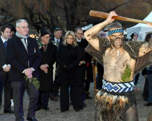 Dressed in war paint and little else, Matua Ned Webster, of Queenstown, leads the official party,...