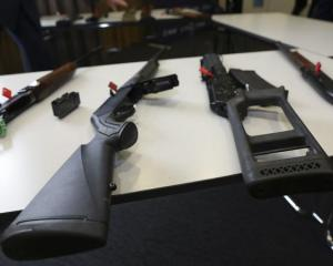 Banned firearms on display at police media conference. Photo: RNZ