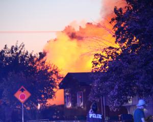 A house burns after gas lines broke during the earthquake in Ridgecrest, California. Photo: via...