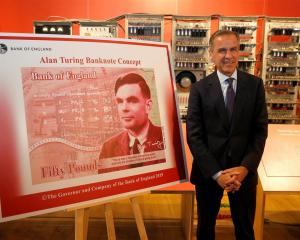 Bank of England governor Mark Carney presents the image of mathematician Alan Turing, which will...